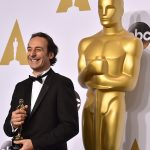 "Alexandre Desplat poses in the press room with the award for best original score in a feature film for ""The Grand Budapest Hotel"" at the Oscars on Sunday, Feb. 22, 2015, at the Dolby Theatre in Los Angeles. (Photo by Jordan Strauss/Invision/AP)"