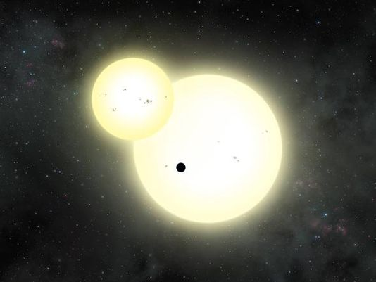 Artist's impression of the planet (black dot) that orbits two suns. (Photo: Lynette Cook)