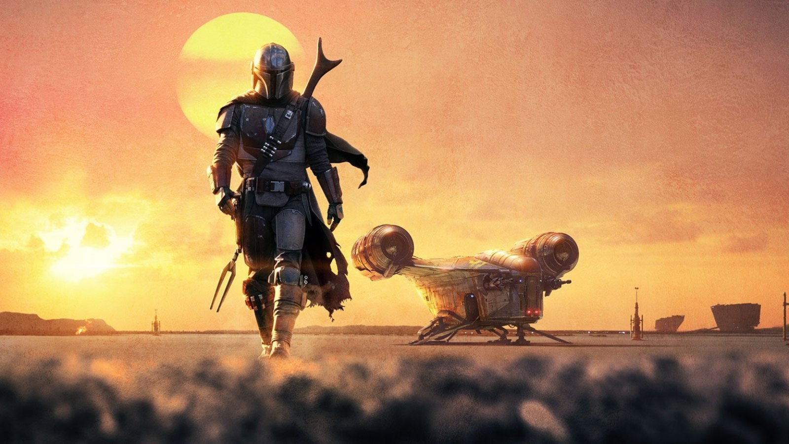 The Mandalorian walking in front of the sunset