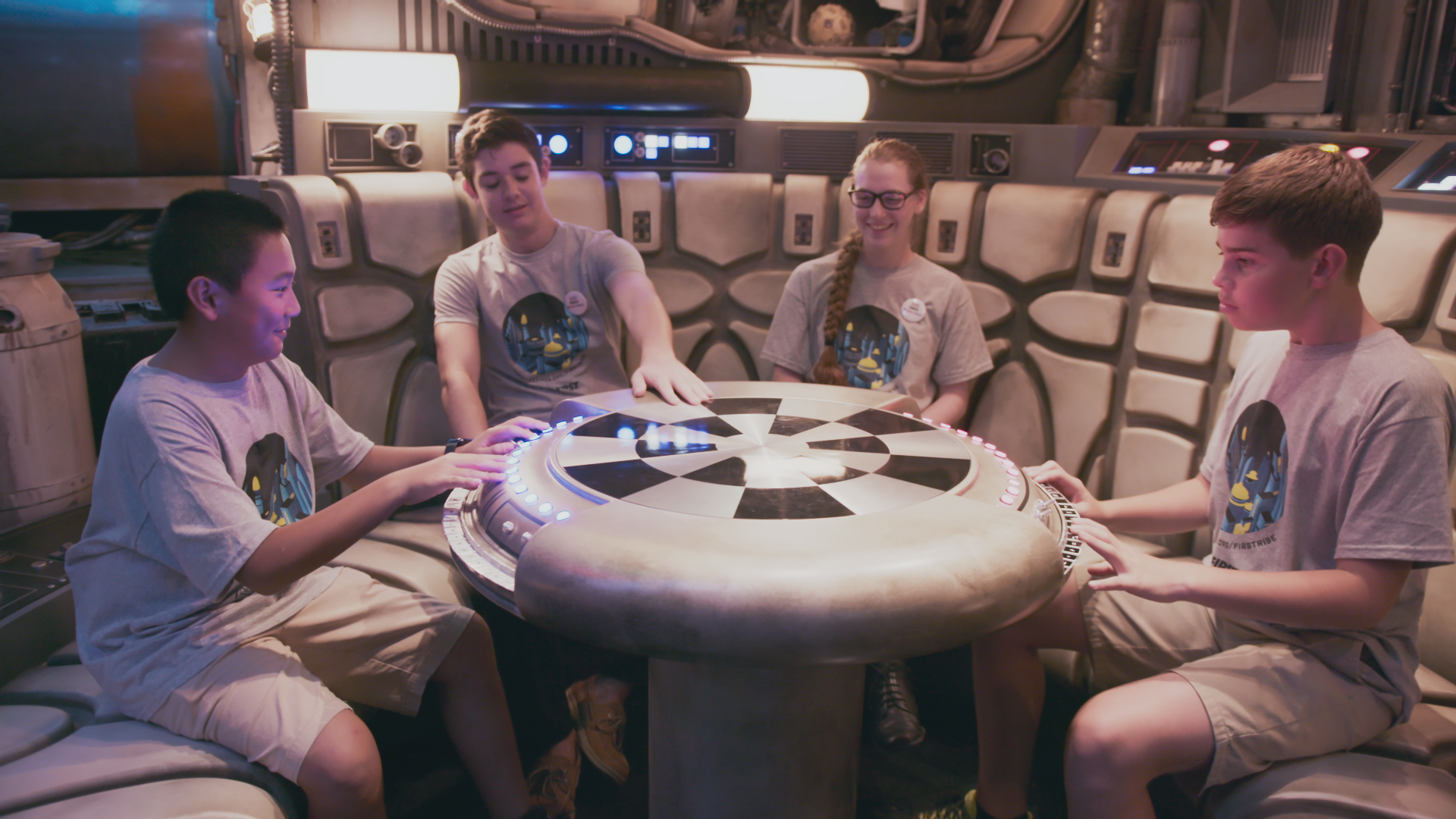 FIRST students sitting at the Millennium Falcon's holochess table