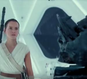 Rey looking at Vader's helmet