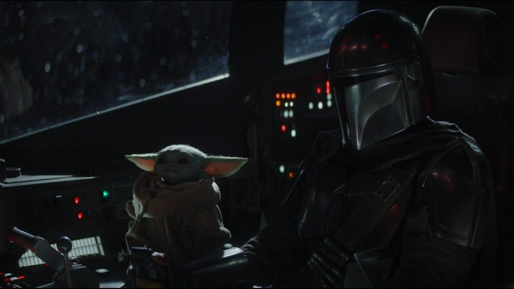 The Mandalorian sitting with The Child
