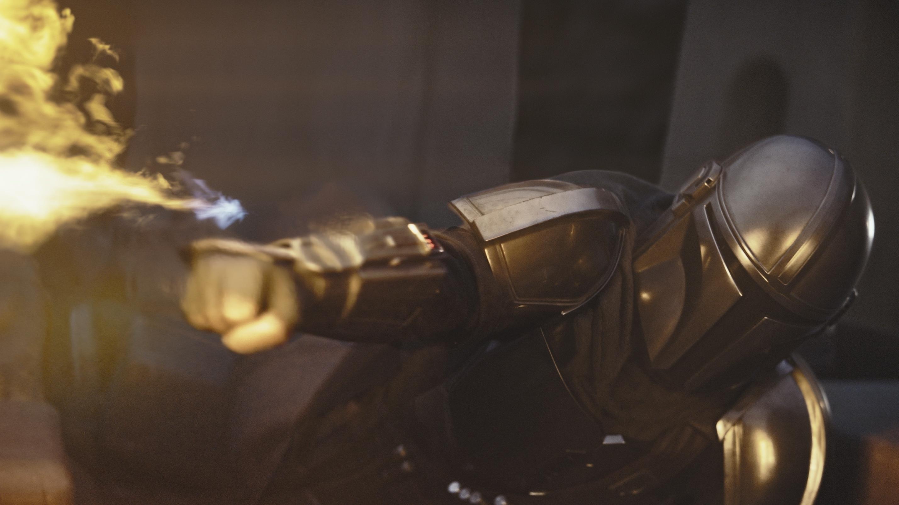 The Mandalorian using his flamethrower
